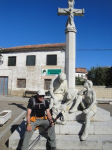 A modern statue paying homage to weary pilgrims on the Camino.