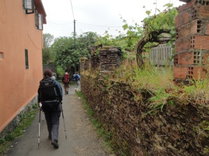 Walking through a typical Galician village.
